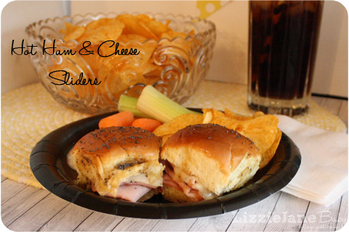 Ham and cheese sliders on hawaiian rolls are the perfect combination of sweet and tangy.  THE perfect party food - lizoncall.com