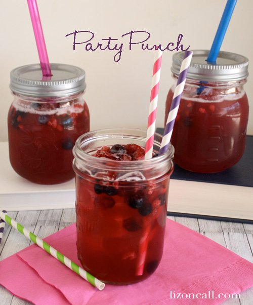 3 mason jar glasses of fresh fruity party punch. The jars are covered with lids and straws are poked through