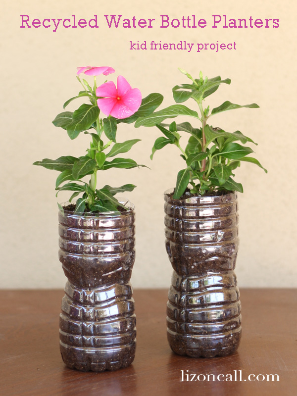 recycled water bottles turned into flower planters - fun #kidcraft or activity for #spring