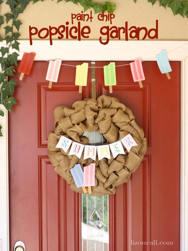 Cute and Fun Popsicle Garland perfect for summer. Made with paint chips from the hardware store. (lizoncall.com) #garland #popsicles #summer #paintchip