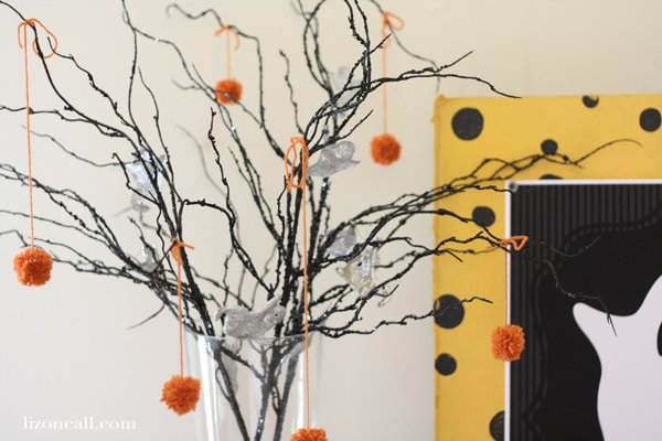 Festive Halloween tree with ghosts and pom poms