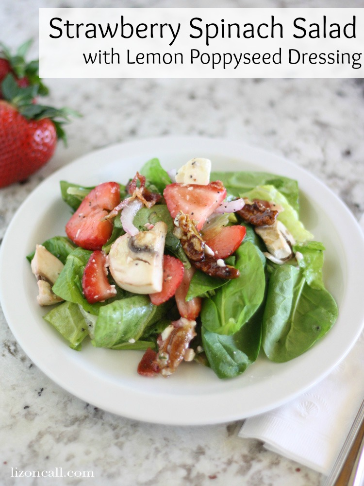 strawberry spinach salad loaded with pecans, bacon, feta, mushrooms, onions and topped with lemon poppyseed dressing. So good! - lizoncall.com
