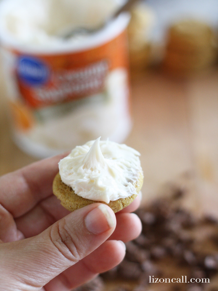 These pumpkin sandwich cookies are bite sized pieces of heaven! People won't believe they are made using a boxed mix. - @lizoncall.com
