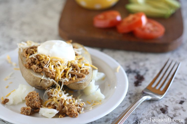 Taco baked potatoes are one of our favorite ways to eat one of our favorite foods!