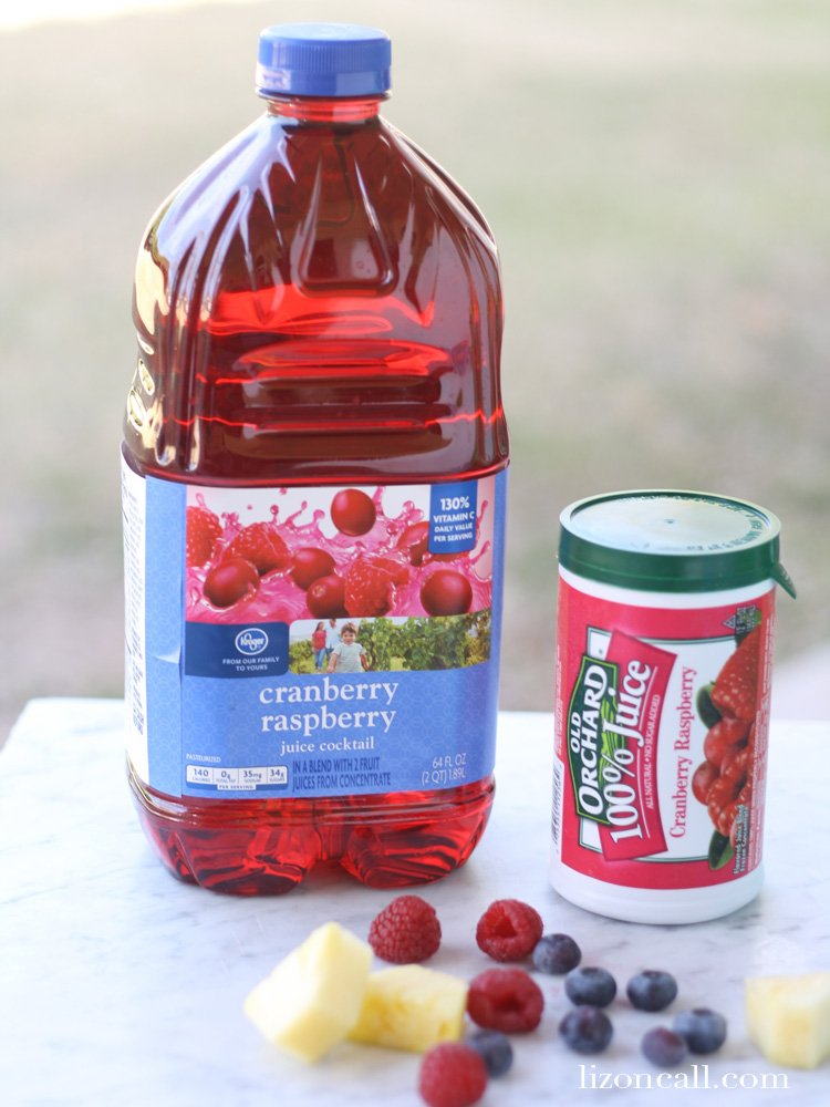 bottle of cranberry-raspberry juice and some fresh fruit for making a punch recipe