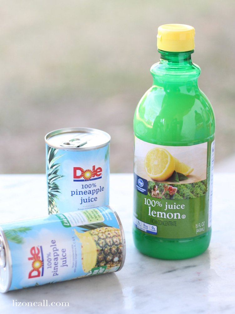 some ingredients to make party punch - 2 cans of pineapple juice and a bottle of lemon juice