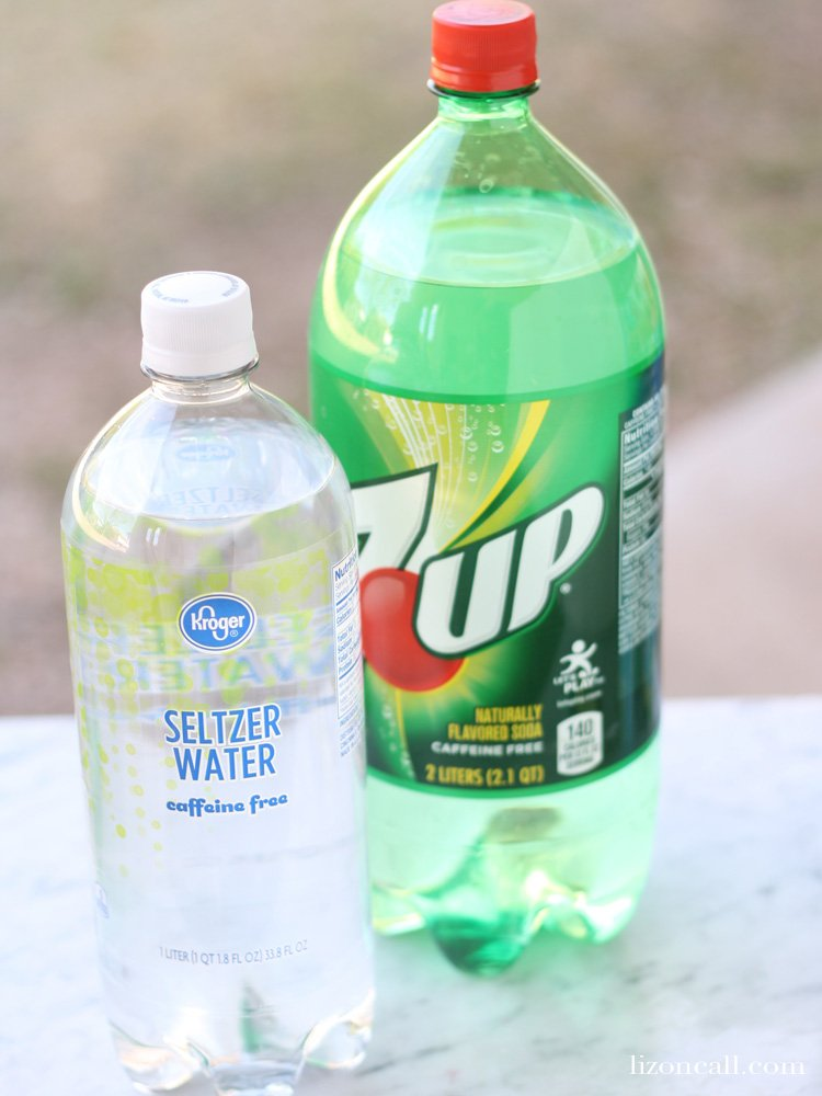 a bottle of 7-Up and a bottle of seltzer water