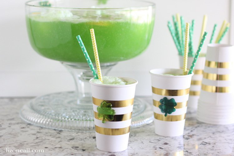 festively decorated glasses for St. Patrick's Day, full of Shamrock Party Punch