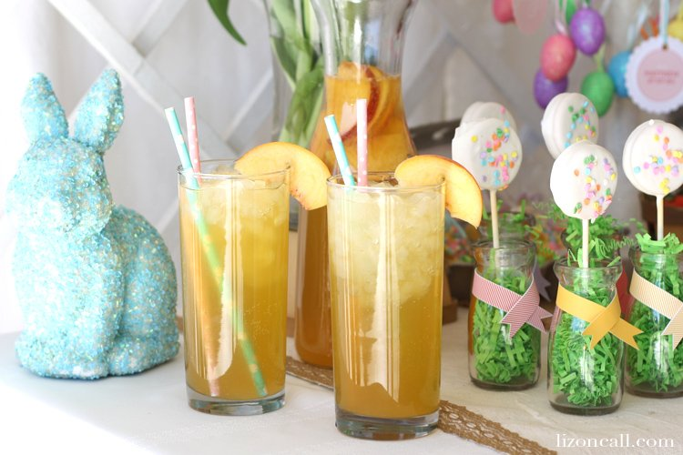 Easter brunch table set up with Easter decor and fresh peach bellini mocktails