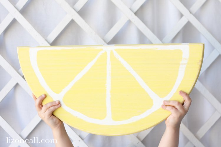 Add pops of color to your summer decor with these DIY painted wood fruit signs.