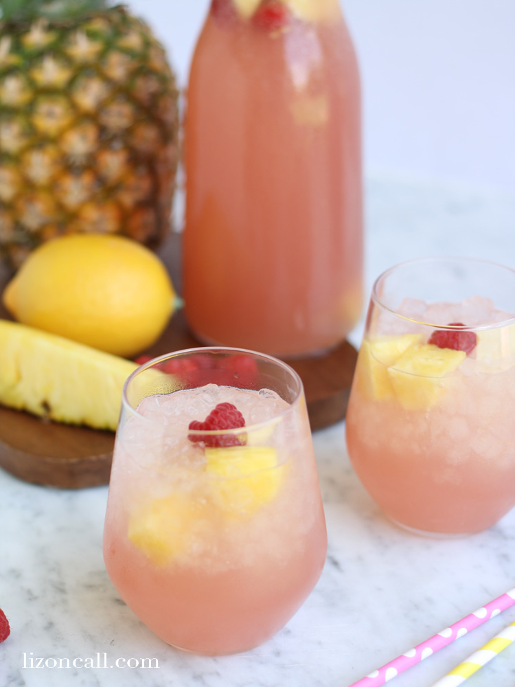 2 Glasses Of Pink Party Punch With Fresh Fruit And Crushed Ice In The  Glasses