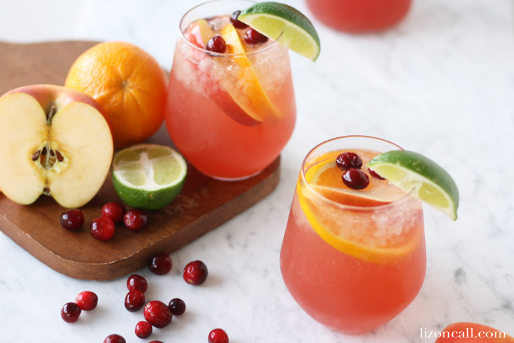 This holiday party punch is perfect for serving at any holiday gathering. Guest young and old will love this easy party punch. @lizoncall.com #partypunch #holiday #christmas