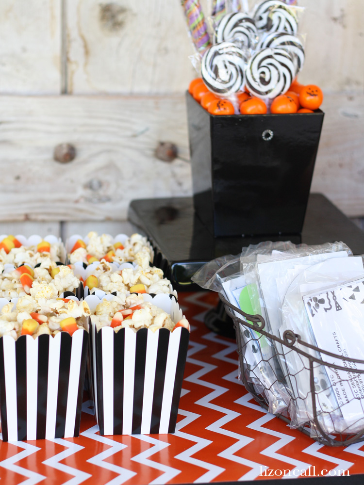 Create a fun and festive Halloween play date for your kids in hosting an easy pumpkin decorating party.