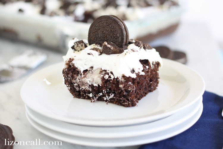 This cookies & cream poke cake is an easy dessert to make if you need a quick treat for a family get together. And it feeds a lot of people.