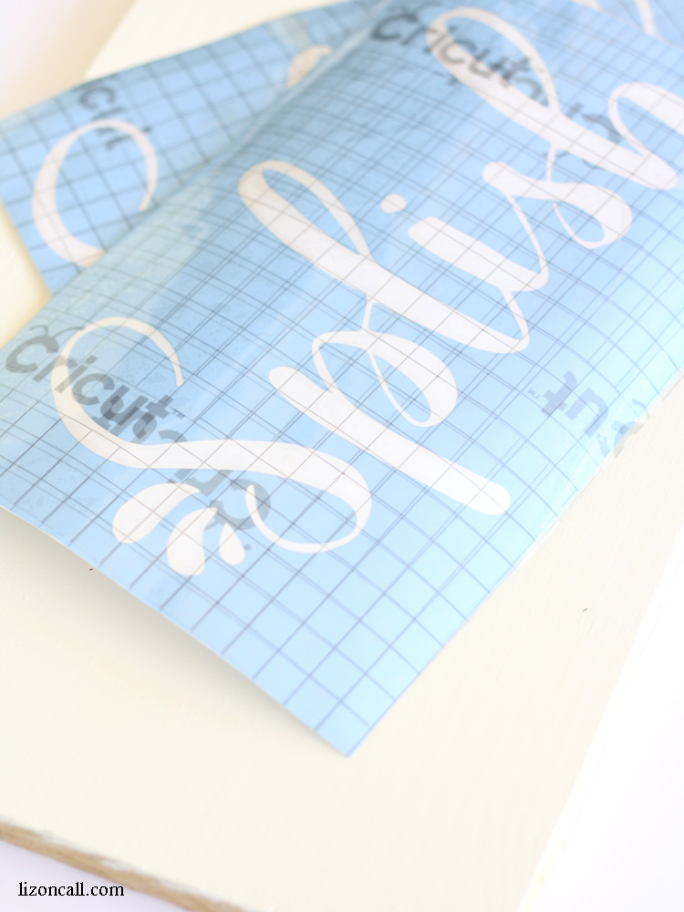 This cute DIY towel hook board was really easy to make with some Cricut stencil vinyl and a free hand lettered cut file.