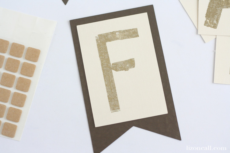 Add a touch of sparkle to your fall decor with this easy DIY gold foil fall banner.