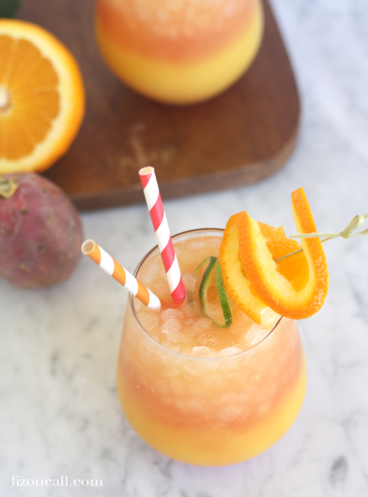 Impress your guests with this beautiful Arizona Sunset Mocktail. It totally reminds me of the colors found in an AZ sunset. #mocktail #partypunch #sunsetmocktail #easypartypunchrecipes
