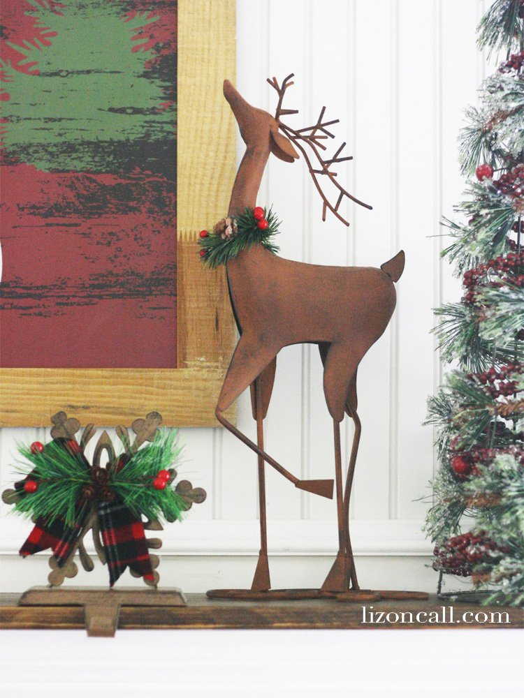 Creating a beautiful and festive holiday mantel can be easy and inexpensive. Here are some tips on how to create a simple Christmas mantel. #christmasmantel #holidaymantel #mantel #christmas
