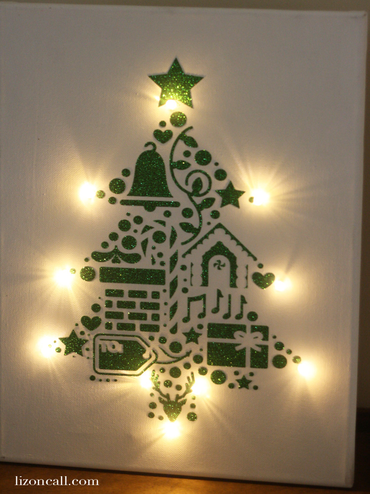 Forget the wreath this year, and create this fun lighted Christmas canvas unwreath door decor using iron on vinyl and a painters canvas. #doordecor #christmas #craft