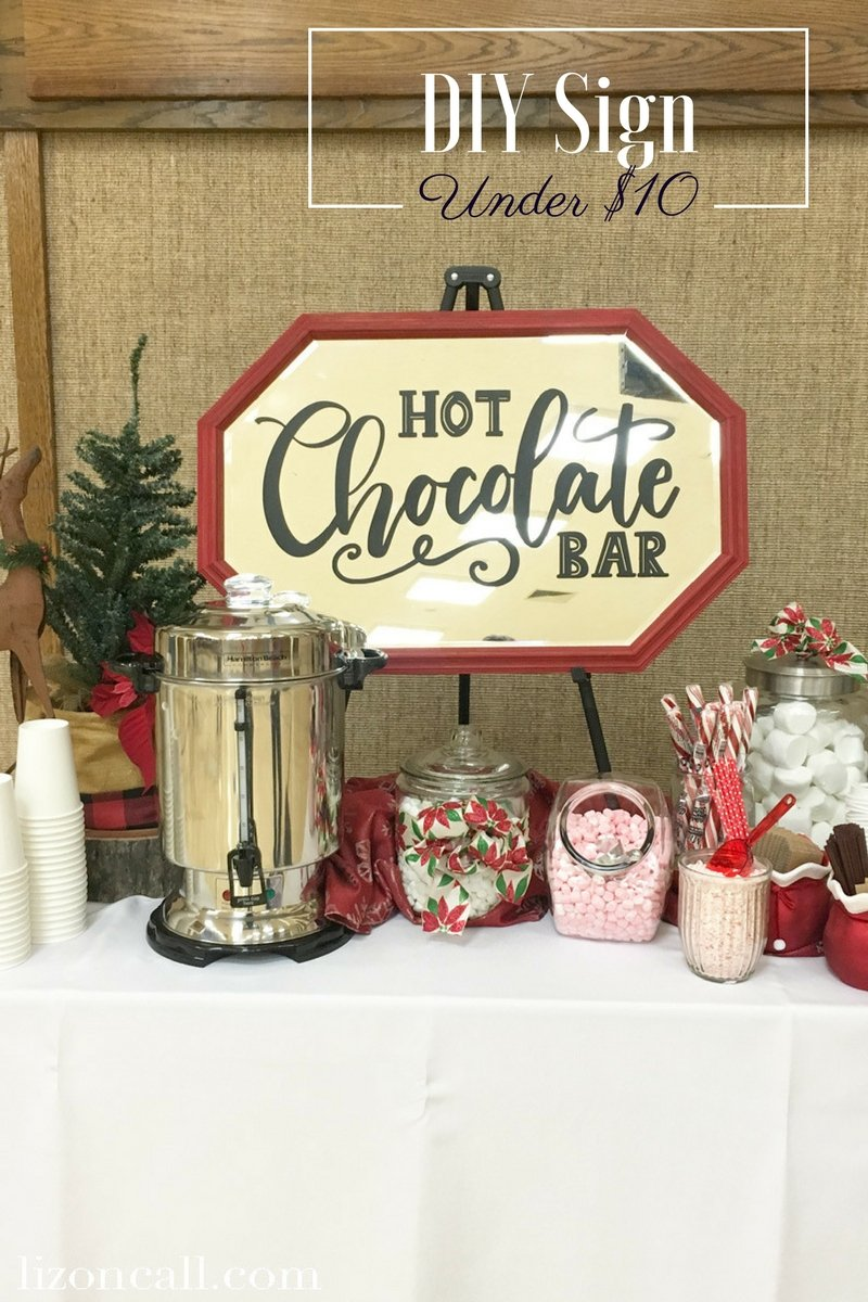 Planning the decor for a fun and festive hot cocoa bar doesn't have to cost a lot.  Create a DIY Hot Chocolate Bar Sign and set up with finds from your local Goodwill. #shopGoodwill #ad #GoodwillDIY #hotcocoabar