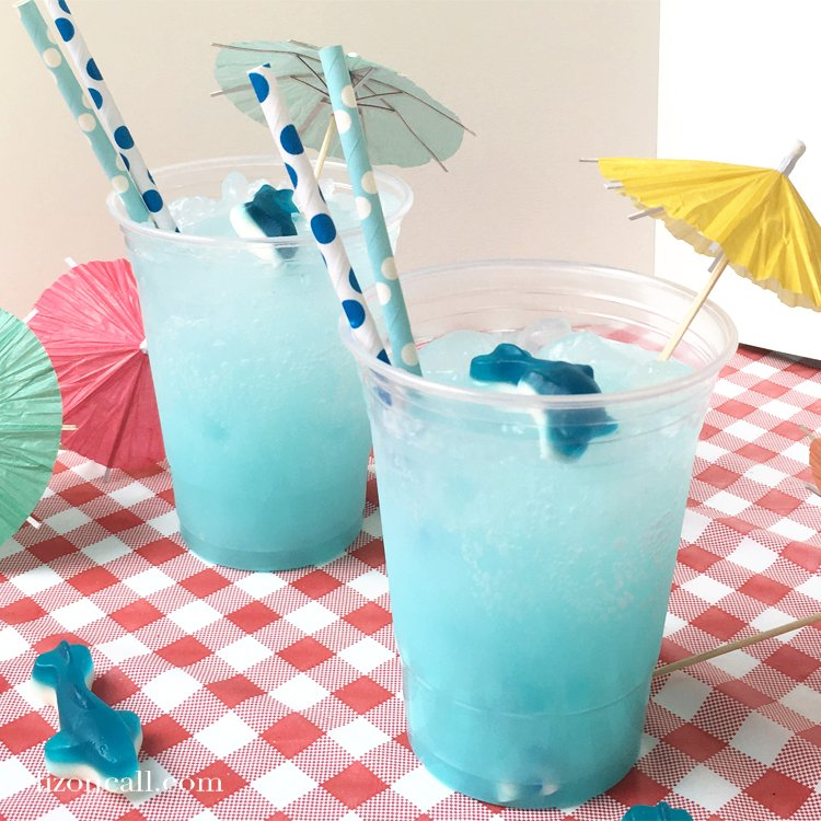 Make your shark week viewing parties extra fun with this easy shark punch.  Guests of all ages will love sipping on this easy party punch recipe perfect for shark week or a hot summer day. #sharkpunch #partypunch