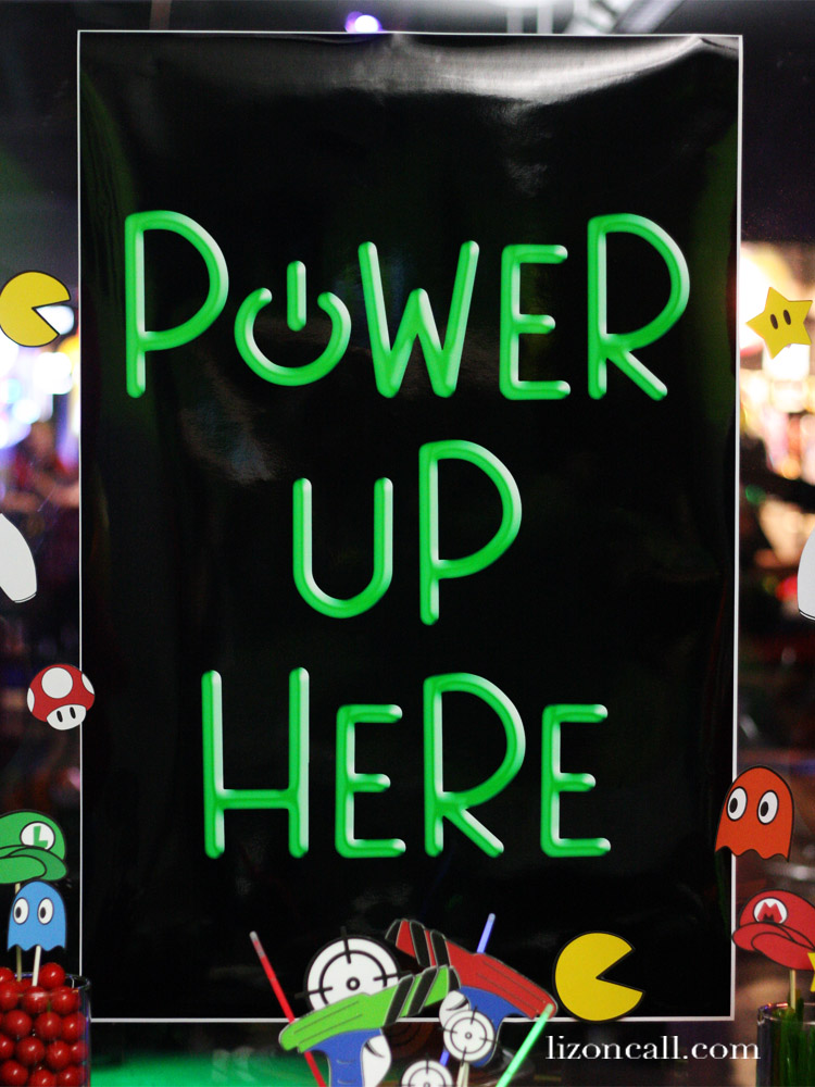 Power Up Here Poster over dessert table at Gaming Party