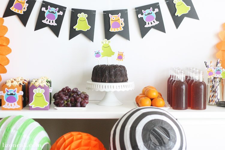 Creating a bright and colorful table and backdrop for a party is easy when you use your Cricut Maker. Create a fun and festive Monster Mash Halloween Party the whole family will love. #ad #halloweenparty #cricutmade #handmadehalloween