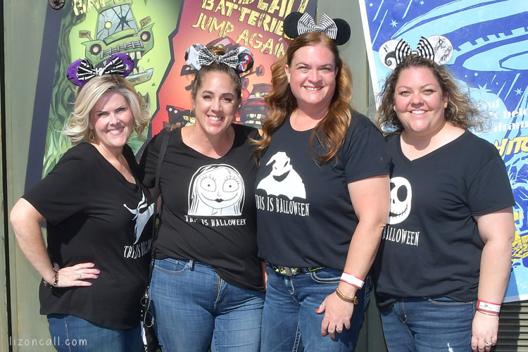 4 women wearing black shirts with Nightmare Before Christmas images.