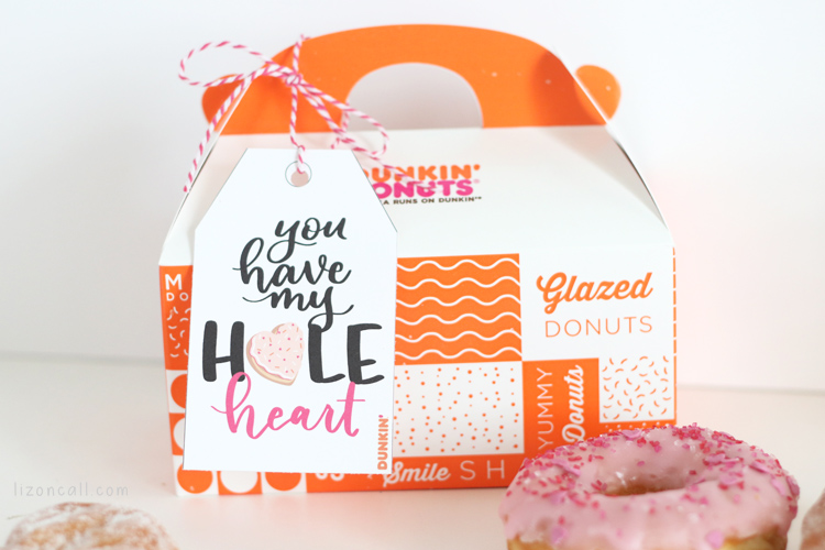 Donut holes box tied with a Donut Valentine printable tag.