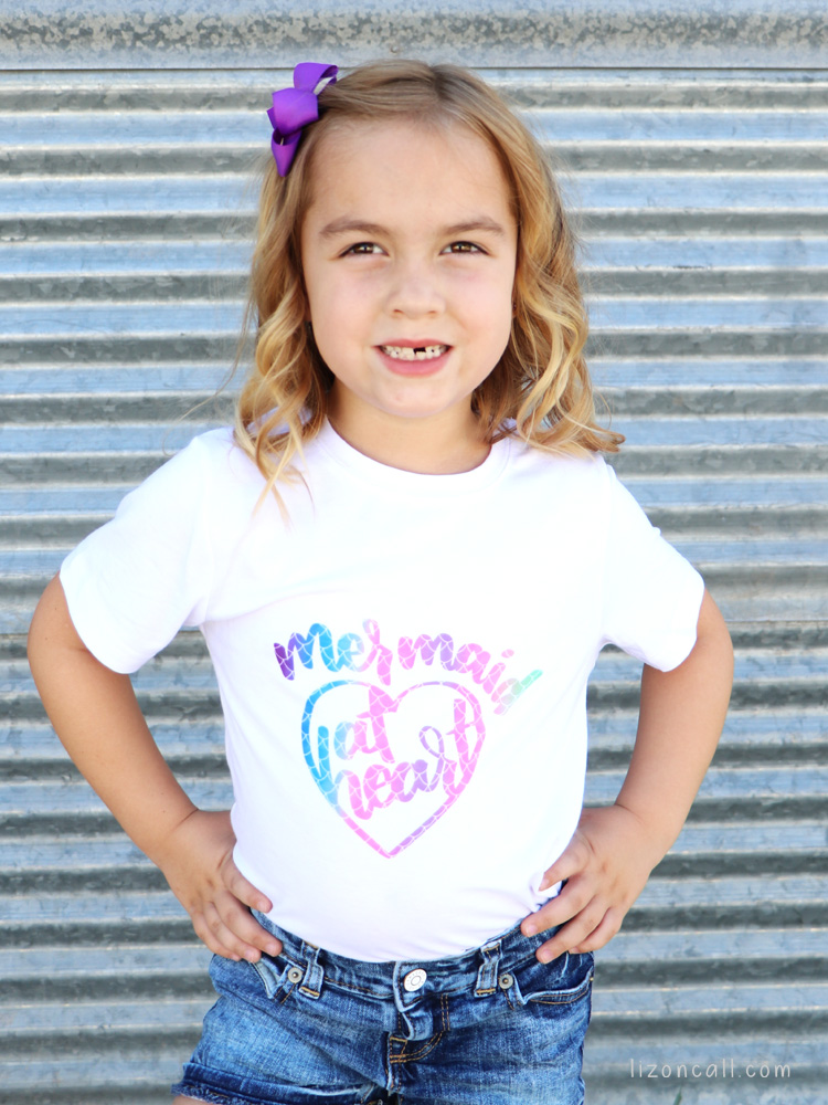 Girl modeling Mermaid at Heart shirt made with Cricut Infusible Ink.