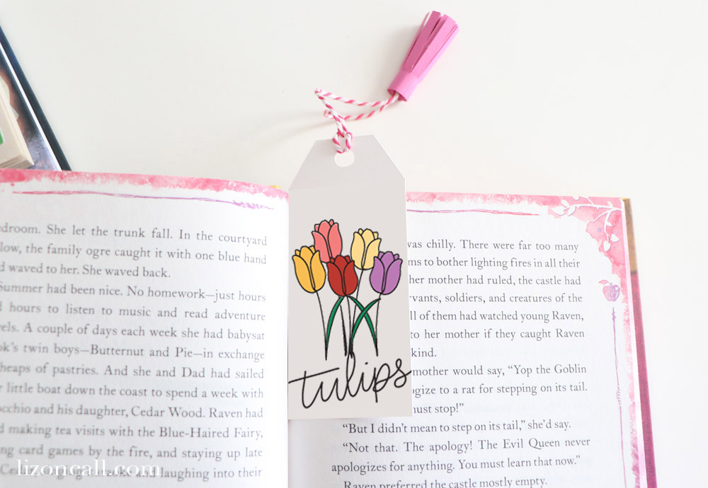 Floral Bookmark marking a page in a book