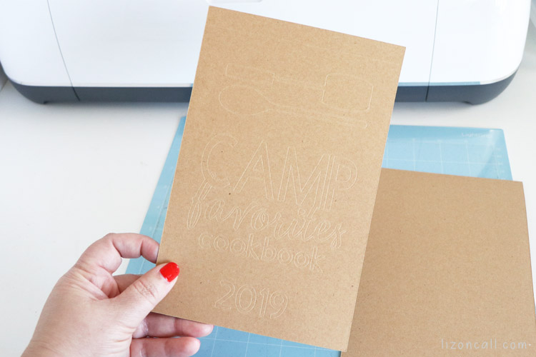 debossed cover for memory book made from kraft board