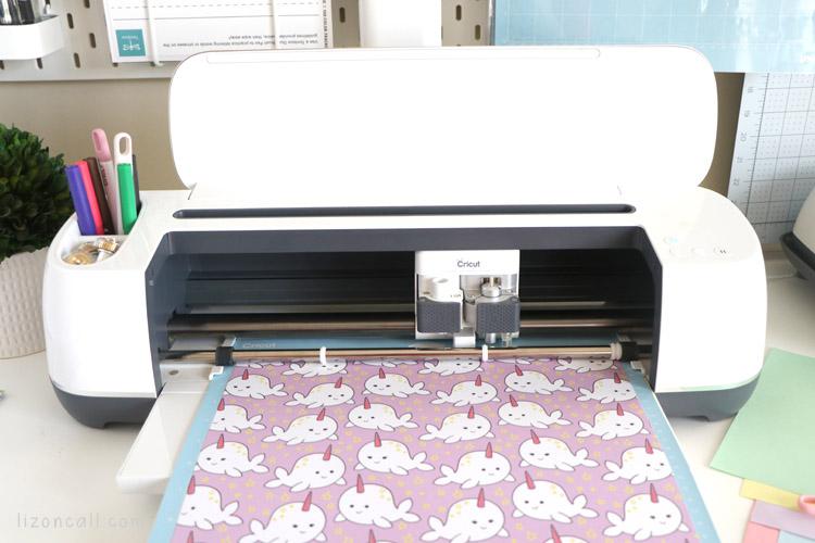 Rad and Happy paper on a Cricut cutting mat loaded into a Cricut maker