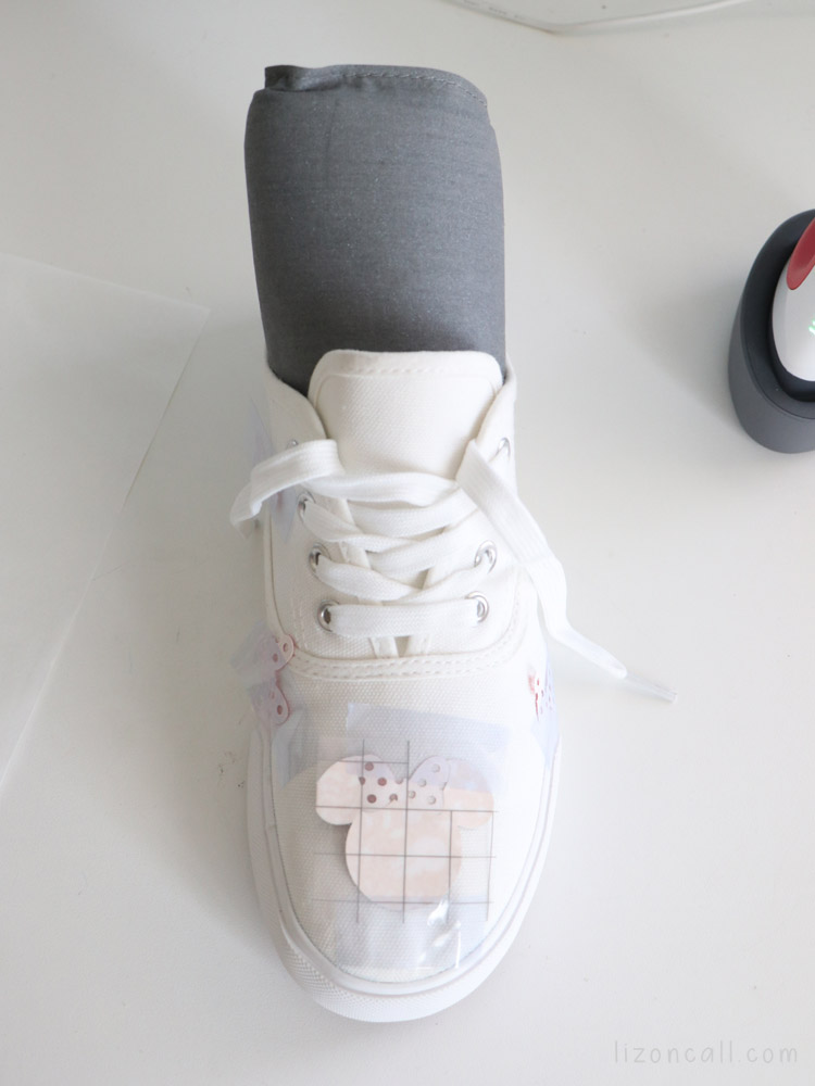 EasyPress mat pushed into canvas shoe to use EasyPress Mini