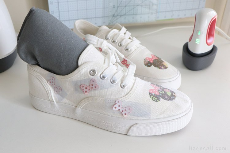 Infusible ink transfer sheet designs taped onto shoes