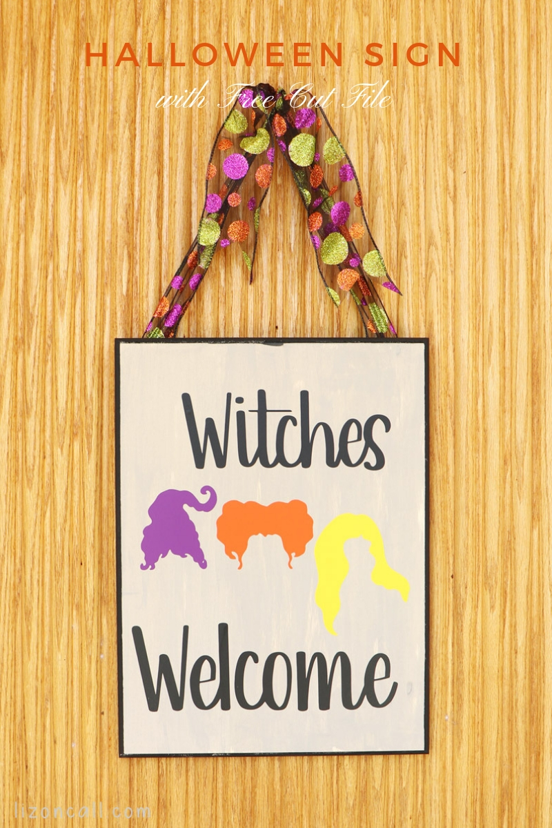 titled image of wooden plaque sign of hocus pocus witches on front door.
