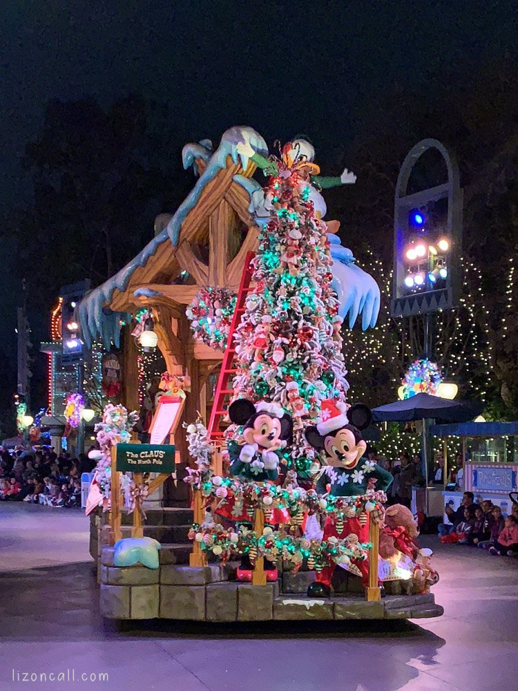 Disneyland holiday parade featuring Mickey and Minnie