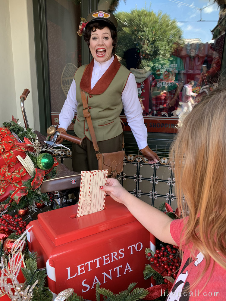 Girl mailing a letter to Santa