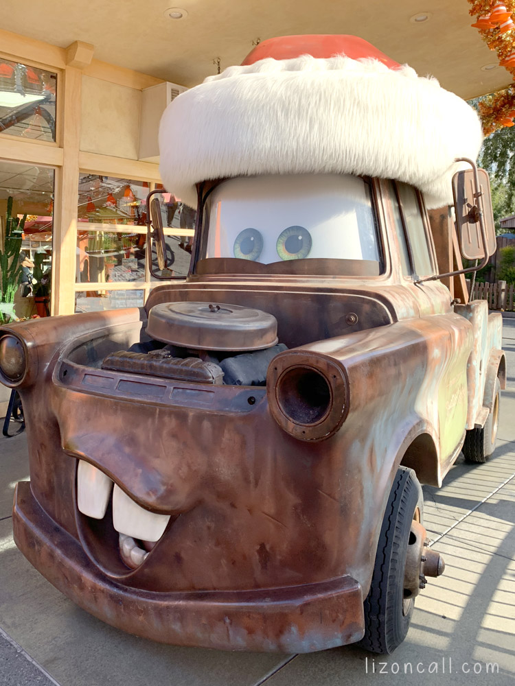Mater from Disney Cars wearing a Santa Hat