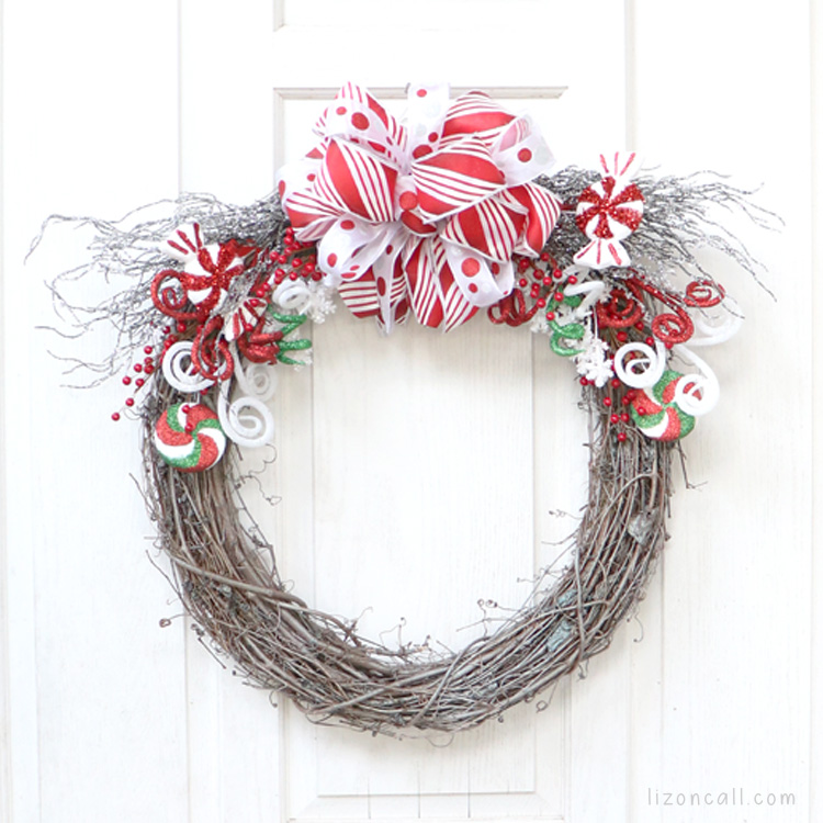 Colorful holiday wreath on a white door.