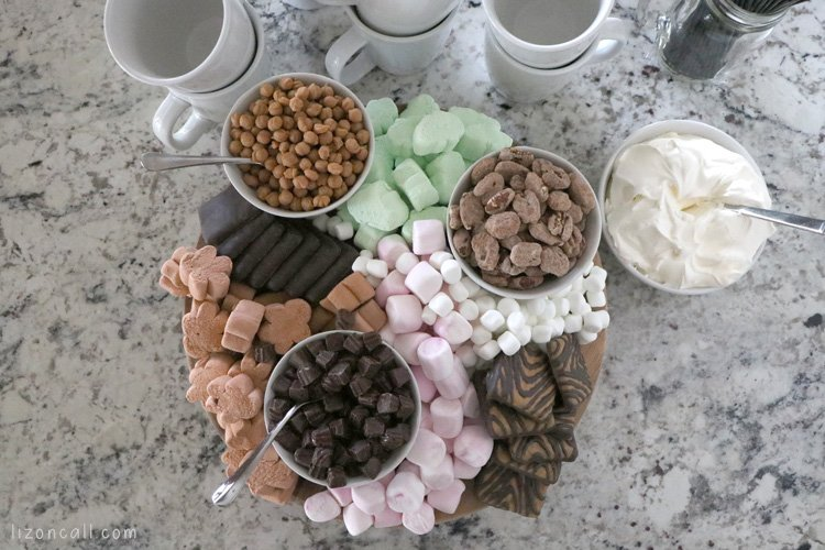 Hot Chocolate snack board with various additions for hot cocoa