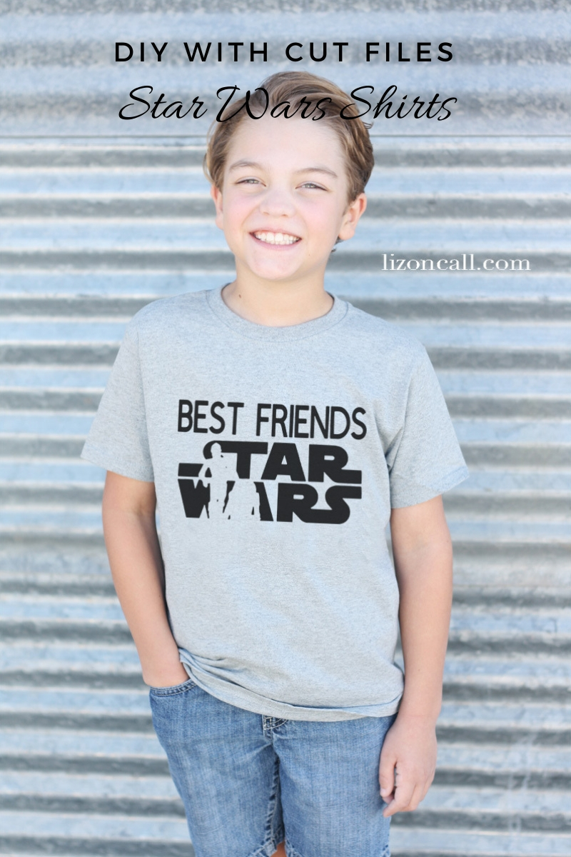 Boy wearing gray t-shirt with star wars droid design