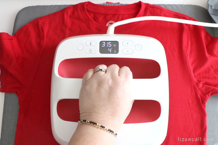 EasyPress 2 pressing an iron on vinyl design to a red shirt