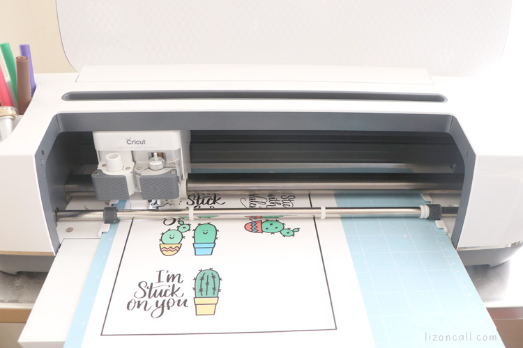 Print and cut cactus valentines loaded into Cricut maker