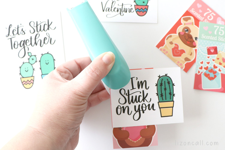 Stapling cactus valentine to sticker book