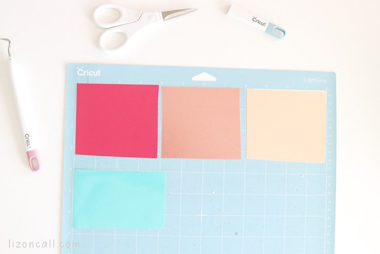 4 colors of vinyl placed on a Cricut cutting mat