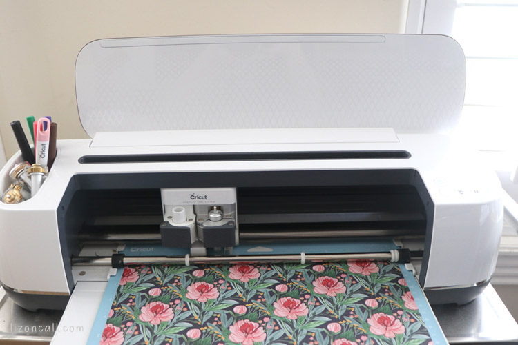 Natalie Malan for Cricut Deluxe paper loaded into Cricut Maker machine