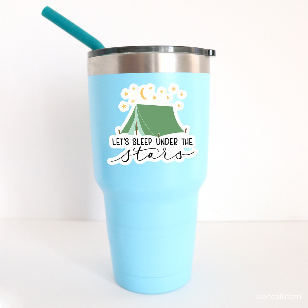 Sleep Under the Stars camping sticker on a tumber cup